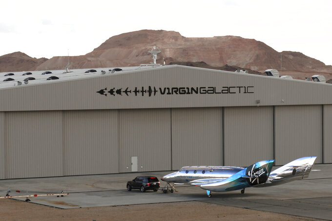 In this undated photo provided by Virgin Galactic is the VSS Imagine, the first SpaceShip III in the Virgin Galactic Fleet in Mojave, Calif. Virgin Galactic rolled out its newest spaceship Tuesday, March 30, 2021, as the company looks to resume test flights in the coming months at its headquarters in the New Mexico desert. Company officials said it will likely be summer before the ship undergoes glide flight testing at Spaceport America in southern New Mexico. (Virgin Galactic via AP)