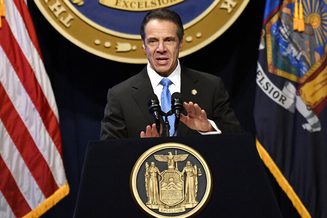 FILE - In this Jan. 8, 2020, file photo, New York Gov. Andrew Cuomo delivers his State of the State address at the Empire State Plaza Convention Center, in Albany, N.Y.  Cuomo faces a Tuesday, Jan. 21, 2020 deadline to release a budget proposal expected to address a looming $6 billion deficit fueled by soaring Medicaid costs. (AP Photo/Hans Pennink, File)