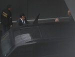 Former Brazilian President Michel Temer, second from right, gets into a federal police vehicle at the international airport in Sao Paulo, Brazil, Thursday, March 21, 2019. In a statement, the Prosecutors Office in Rio de Janeiro said that Judge Marcelo Breitas had issued an arrest order for Temer, as well as Moreira Franco, a former minister and close ally of Temer, and eight others. (AP Photo/Andre Penner)