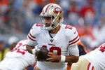 FILE - In this Aug. 19, 2019, file photo, San Francisco 49ers quarterback Jimmy Garoppolo (10) looks to hand the ball off during the first half of the team's NFL preseason football game against the Denver Broncos in Denver. Garoppolo remains a mostly untested commodity with 10 career starts in five seasons and has struggled in training camp and exhibitions. He must show that the Niners made the right choice when they invested in him. (AP Photo/David Zalubowski, File)