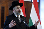 Ashkenazi Chief Rabbi of Israel David Lau delivers his speech during a signing ceremony of a comprehensive agreement between Deputy prime minister in charge of Hungarian communities abroad, church policy and national and ethnic minorities, Zsolt Semjen and Chief Rabbi of the Unified Israelite Congregation of Hungary (EMIH) Slomo Koves the Castle District premises of the Prime Minister's Office, in Budapest, Hungary, Monday, Nov. 18, 2019. By signing the agreement, the Hungarian state acknowledges the historical traditions of the Jewish community and