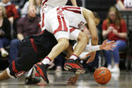 Washington State guard Jervae Robinson, top, and Stanford guard Bryce Wills go after the ball during the second half of an NCAA college basketball game in Pullman, Wash., Sunday, Feb. 23, 2020. Stanford won 75-57. (AP Photo/Young Kwak)