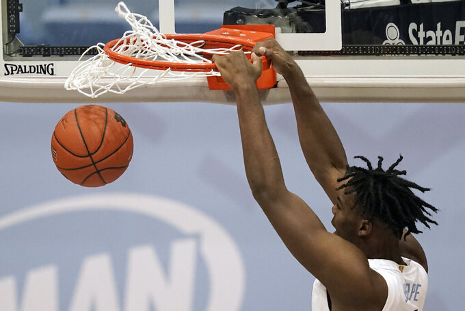 North Carolina forward Day'Ron Sharpe (11) dunks against North Carolina Central during the second half of an NCAA college basketball game in Chapel Hill, N.C., Saturday, Dec. 12, 2020. (AP Photo/Gerry Broome)