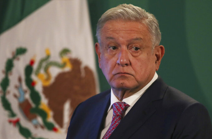 FILE - In this Feb. 8, 2021 file photo, Mexican President Andres Manuel Lopez Obrador gives his daily morning press conference following a two-week absence after he tested positive for the new coronavirus, at the National Palace in Mexico City. The Mexican leader has refused to mandate mask wearing or a declare any lockdown. And his obsessive drive to slash government spending may have contributed to the safety downgrade, which apparently involved insufficient staffing and oversight at airports. Lopez Obrador lashed out on both fronts Thursday, May 27, 2021, criticizing other governments rather than recognize any Mexican shortcomings. (AP Photo/Marco Ugarte, File)