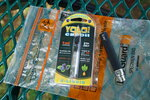 A Yolo! brand CBD oil vape cartridge sits alongside a vape pen on a biohazard bag on a table at a park in Ninety Six, S.C., on Wednesday, May 8, 2019. Jay Jenkins says two hits from the vape put him in a coma and nearly killed him in 2018. Lab testing commissioned by The Associated Press shows this cartridge and several other vapes marketed as delivering CBD instead contained synthetic marijuana, a street drug commonly known as K2 or spice. (AP Photo/Allen G. Breed)