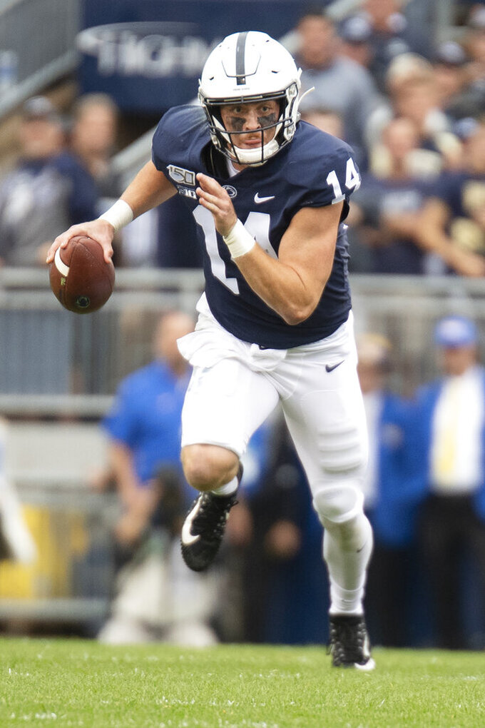 FILE - In this Sept. 14, 2019, file photo, Penn State quarterback Sean Clifford (14) scrambles during an NCAA college football game against Pittsburgh, in State College, Pa. Penn State (8-0) plays against Minnesota (8-0)  on Saturday, Nov. 9. (AP Photo/Barry Reeger, File)