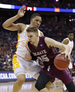 Colgate's Rapolas Ivanauskas, right, drives past Tennessee's Grant Williams in the first half of a first-round game in the NCAA men's college basketball tournament in Columbus, Ohio, Friday, March 22, 2019. (AP Photo/Tony Dejak)