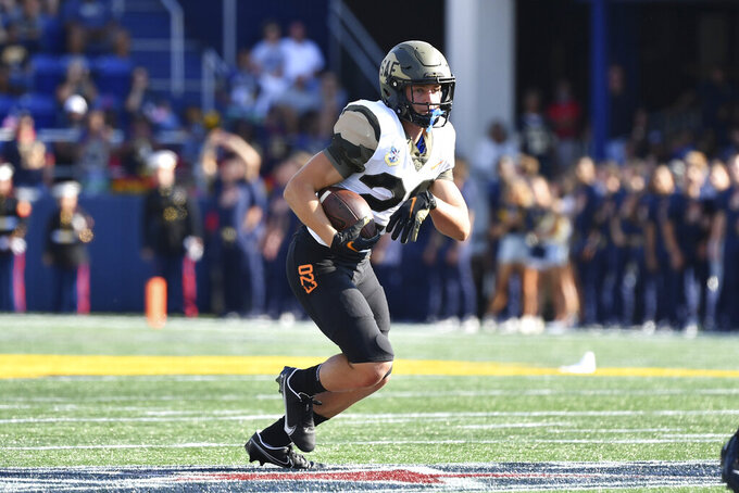 Air Force wide receiver Dane Kinamon runs the ball during the first half of an NCAA college football game against Navy, Saturday, Sept. 11, 2021, in Annapolis, Md. (AP Photo/Terrance Williams)