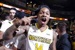 FILE- In this March 10, 2020, file photo, Northern Kentucky guard Karl Harris (14) celebrates following an NCAA college basketball game against Illinois Chicago in the Horizon League men's tournament championship in Indianapolis. Another dream, of playing in the NCAA Tournament, became a reality when Northern Kentucky clinched the Horizon League tournament title in March.  Mere hours later, it was snatched away by a pandemic spiderwebbing across the globe. (AP Photo/Michael Conroy, File)