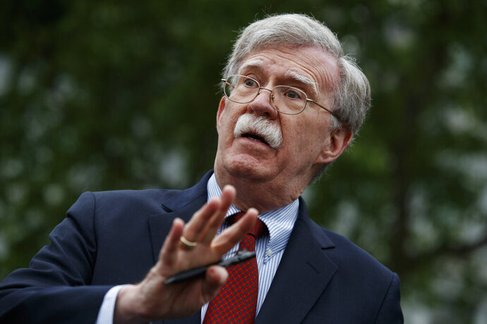 FILE - In this May 1, 2019 file photo, National security adviser John Bolton talks to reporters outside the White House in Washington. (AP Photo/Evan Vucci)
