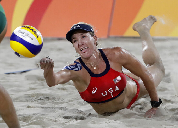 FILE - In this Aug. 17, 2016, file photo, United States' Kerri Walsh Jennings digs for a ball while playing Brazil during the women's beach volleyball bronze medal match of the Summer Olympics in Rio de Janeiro, Brazil. During the coronavirus pandemic, beach volleyball star Walsh Jennings has been doing online talks with young volleyball players, including one with the team at her alma mater of Archbishop Mitty H.S. in California. (AP Photo/Marcio Jose Sanchez, File)