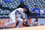Minnesota Twins' Andrelton Simmons (9) slides in safely at third base past the tag of Milwaukee Brewers' Orlando Arcia during the eighth inning of a baseball game Sunday, April 4, 2021, in Milwaukee. (AP Photo/Aaron Gash)