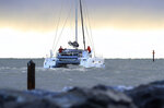 The 48-foot (15-meter) catamaran La Vagabonde departs Salt Ponds in Hampton, Va., with Swedish teen climate activist Greta Thunberg aboard Wednesday, Nov. 13, 2019.  Thunberg left North America on a return trip across the Atlantic hitching a renewable-energy ride with an Australian family aboard their catamaran.  (Rob Ostermaier/The Virginian-Pilot via AP)