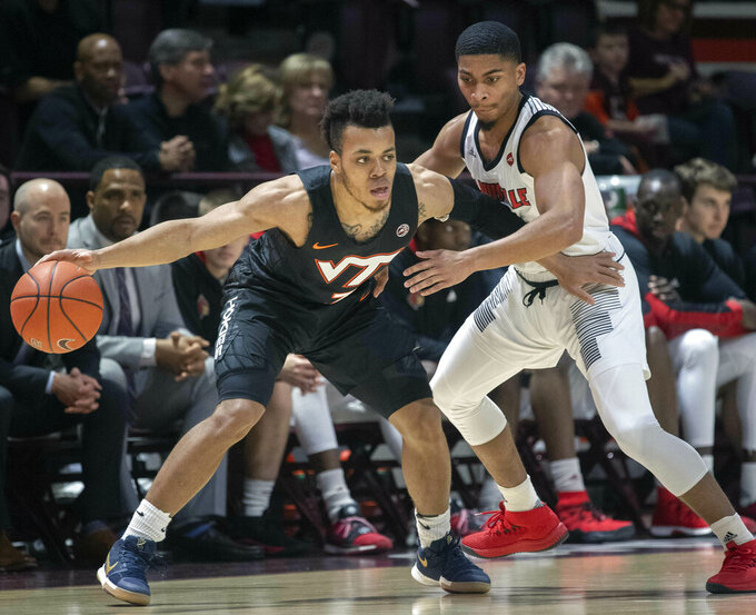 Virginia Tech Hokies guard Wabissa Bede (3) looks to pass against Louisville guard Christen Cunningham (1) during the first half of an NCAA college basketball game Monday, Feb. 4, 2019, in Blacksburg, Va. Louisville won 72-64. (AP Photo/Don Petersen)
