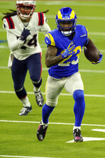 Los Angeles Rams running back Cam Akers (23) runs against the New England Patriots during the first half of a NFL football game Thursday, Dec. 10, 2020, in Inglewood, Calif. (AP Photo/Ashley Landis)