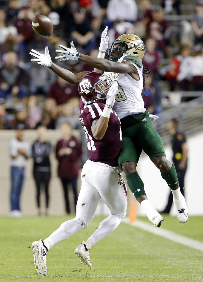 Texas A&M defensive back Charles Oliver, left, breaks up a pass intended for UAB wide receiver Kailon Carter, right, during the first half of an NCAA college football game Saturday, Nov. 17, 2018, in College Station, Texas. (AP Photo/Michael Wyke)
