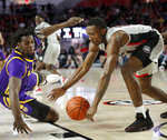 Georgia guard Tye Fagan (14) scoops up the ball against LSU forward Naz Reid (0) during the first half of an NCAA college basketball game Saturday, Feb. 16, 2019, in Athens, Ga. (AP Photo/John Bazemore)