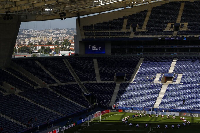 Chelsea's players stretch during a training session ahead of the Champions League final match at the Dragao stadium in Porto, Portugal, Friday, May 28, 2021. Manchester City and Chelsea will play the Champions League final on Saturday. (Susana Vera/Pool via AP)