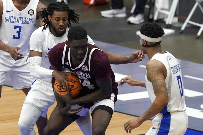 Saint Louis forward Terrence Hargrove Jr., left, and Jordan Goodwin (0) attempt to wrestle the ball away from Mississippi State forward Abdul Ado (24) during the first half of an NCAA college basketball game in the first round of the NIT Tournament, Saturday, March 20, 2021, in Frisco, Texas. (AP Photo/Tony Gutierrez)