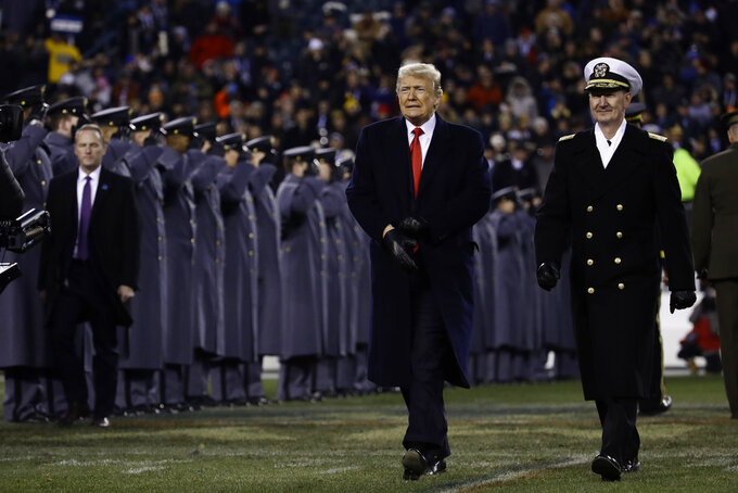 President Donald Trump, left, walks with Naval Academy Superintendent Vice Adm. Ted Carter, right, across the field after the first half of an NCAA college football game between the Army and the Navy, Saturday, Dec. 8, 2018, in Philadelphia. (AP Photo/Matt Rourke)