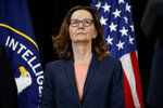 FILE - This Monday, May 21, 2018 file photo shows incoming Central Intelligence Agency director Gina Haspel at the agency's headquarters in Langley, Va. On Friday, Sept. 20, 2019, The Associated Press reported on stories circulating online incorrectly asserting that a photo shows Haspel giving a thumbs-up sign next to the body of a tortured Iraqi man in Abu Ghraib prison. The photo shows former Army Spc. Sabrina Harman, who was in several 2003 photographs taken at the prison that depicted abuse of prisoners. (AP Photo/Evan Vucci)