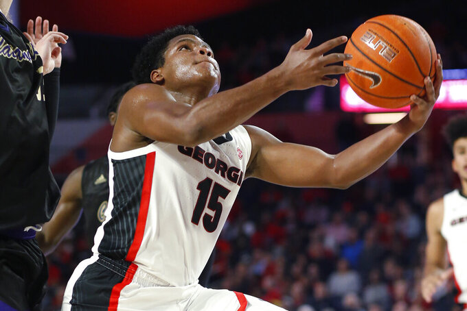 Georgia's Sahvir Wheeler (15) shoots against Western Carolina during an NCAA college basketball game Tuesday, Nov. 5, 2019, in Athens, Ga. (Joshua L. Jones/Athens Banner-Herald via AP)