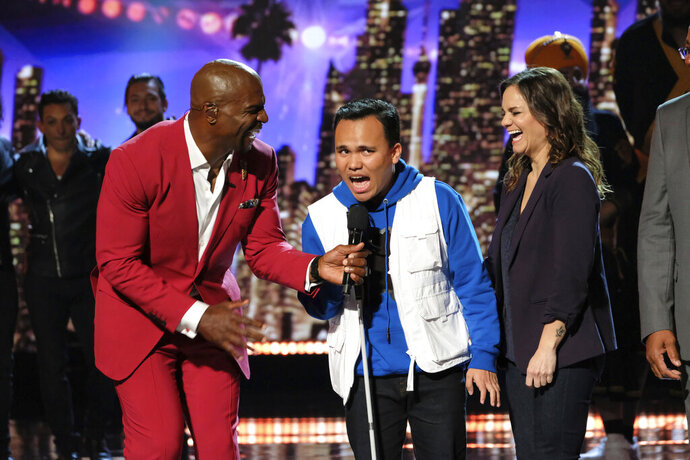This Wednesday, Aug. 14, 2019 photo provided by NBC shows host Terry Crews, left, and singer Kodi Lee on the NBC television show,