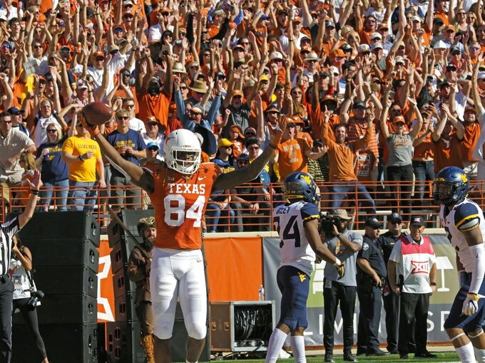 Lil'Jordan Humphrey (84) celebrates his touchdown during the first half of an NCAA college football game against West Virginia, Saturday, Nov. 3, 2018, in Austin, Texas. (AP Photo/Michael Thomas)