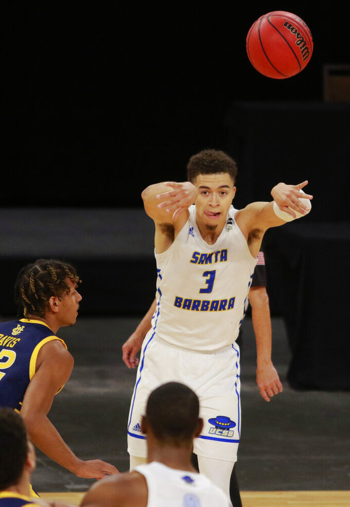 UC Santa Barbara's Jaquori McLaughlin (3) throws a pass during the second half of an NCAA college basketball game for the championship of the Big West Conference men's tournament Saturday, March 13, 2021, in Las Vegas. (AP Photo/Ronda Churchill)