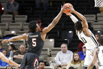 South Carolina's Jermaine Couisnard (5) reaches for the ball as Vanderbilt's Saben Lee (0) shoots in the first half of an NCAA college basketball game Saturday, March 7, 2020, in Nashville, Tenn. (AP Photo/Mark Humphrey)