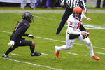 Illinois quarterback Brandon Peters, right, runs with the ball against Northwestern defensive back Cameron Mitchell during the first half of an NCAA college basketball game in Evanston, Ill., Saturday, Dec. 12, 2020. (AP Photo/Nam Y. Huh)