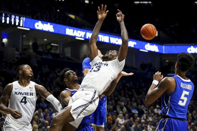 Xavier forward Naji Marshall (13) loses the ball in the first half of an NCAA college basketball game against Creighton Saturday, Jan. 11, 2020, in Cincinnati. (Kareem Elgazzar/The Cincinnati Enquirer via AP)