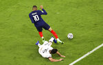 France's Kylian Mbappe, left, and Germany's Mats Hummels, right, challenge for the ball during the Euro 2020 soccer championship group F match between France and Germany at the Allianz Arena stadium in Munich, Tuesday, June 15, 2021. (AP Photo/Alexander Hassenstein, Pool)