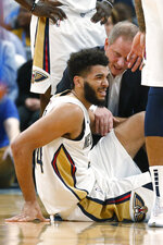 New Orleans Pelicans guard Kenrich Williams is attended to after an injury during the first half of the team's NBA basketball game against the Oklahoma City Thunder on Friday, Nov. 29, 2019, in Oklahoma City. (AP Photo/Sue Ogrocki)