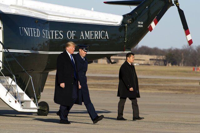 President Donald Trump escorted by Col. Brian Daniels walks to board Air Force One at Andrews Air Force Base, Md., Friday, Jan. 17, 2020, en route to his Mar-a-Lago estate, in Palm Beach, Fla. ( AP Photo/Jose Luis Magana)