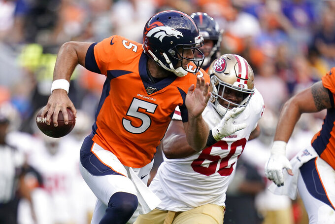 Denver Broncos quarterback Joe Flacco (5) scrambles as San Francisco 49ers defensive tackle Kevin Givens (60) pursues during an NFL preseason football game, Monday, Aug. 19, 2019, in Denver. (AP Photo/Jack Dempsey)