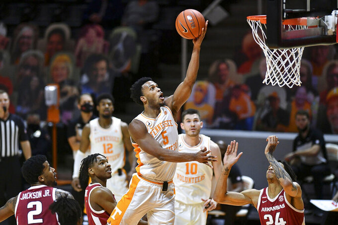 Tennessee's Josiah-Jordan James (5) attempts to score against Arkansas during an NCAA college basketball game Wednesday, Jan. 6, 2021, in Knoxville, Tenn. (Saul Young/Knoxville News Sentinel via AP, Pool)