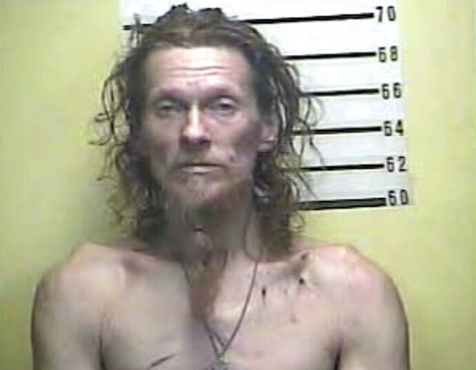 This image provided by the Bell County Detention Center shows Charles E. Lawson, who was arrested Monday morning, June 24, 2019, following a standoff with police in Bell County, Ky. Kentucky State Police say lawson is accused of firing shots into a residence, starting a fire and shooting at responding officers. (Bell County Detention Center via AP)