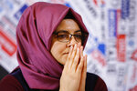 FILE - IN this Dec. 17, 2019 file photo, Hatice Cengiz, fiancee of late journalist Jamal Khashoggi who was kidnapped and killed during a visit to the Arabian consulate in Istanbul on Oct. 2018, gestures during a press conference at the Foreign Press Association in Rome. A court in Saudi Arabia has sentenced five people to death for the killing of Washington Post columnist Jamal Khashoggi, who was murdered in the Saudi Consulate in Istanbul last year by a team of Saudi agents. Saudi Arabia's state TV reported Monday, Dec. 23, 2019 that three others were sentenced to prison. All can appeal the verdicts.  (AP Photo/Domenico Stinellis, File)
