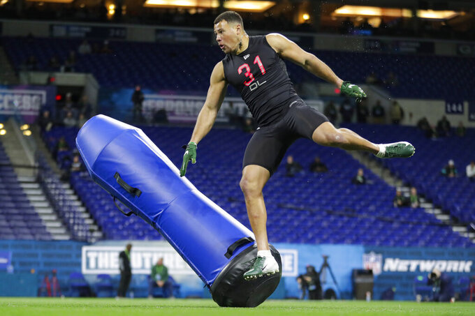 Charlotte defensive lineman Alex Highsmith runs a drill at the NFL football scouting combine in Indianapolis, Saturday, Feb. 29, 2020. (AP Photo/Michael Conroy)