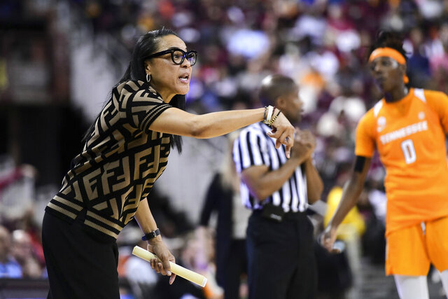 South Carolina coach Dawn Staley communicates with players during the first half of an NCAA college basketball game against Tennessee, Sunday, Feb. 2, 2020, in Columbia, S.C. (AP Photo/Sean Rayford)