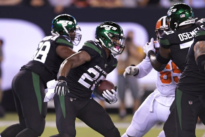 New York Jets running back Le'Veon Bell (26) rushes during the first half of an NFL football game against the Cleveland Browns, Monday, Sept. 16, 2019, in East Rutherford, N.J. (AP Photo/Bill Kostroun)