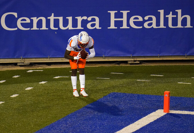 Boise State wide receiver CT Thomas celebrates after catching a pass for touchdown against Air Force during the second half of an NCAA college football game Saturday, Oct. 31, 2020, at Air Force Academy, Colo. (AP Photo/David Zalubowski)