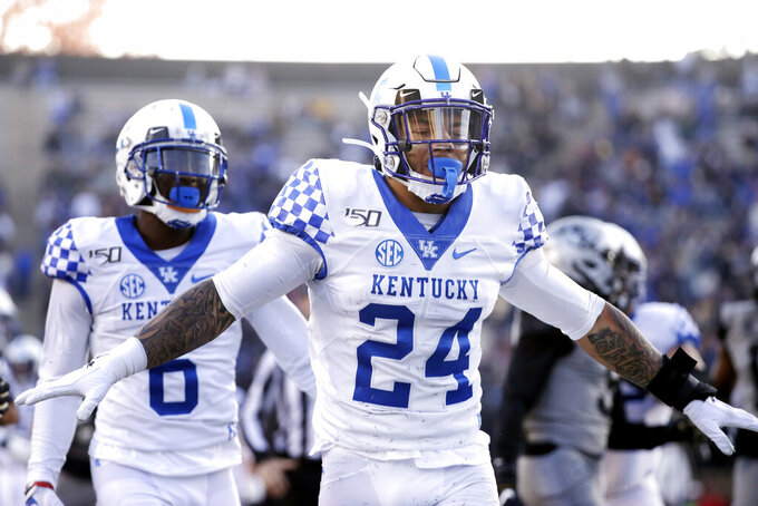 Kentucky running back Christopher Rodriguez Jr. (24) celebrates after a 22-yard touchdown run against Vanderbilt in the first half of an NCAA college football game Saturday, Nov. 16, 2019, in Nashville, Tenn. (AP Photo/Mark Humphrey)
