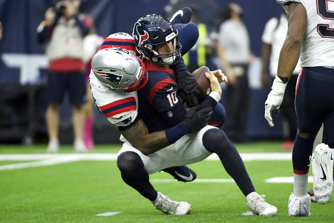 Houston Texans quarterback Davis Mills (10) is sacked by New England Patriots linebacker Jamie Collins Sr. during the second half of an NFL football game Sunday, Oct. 10, 2021, in Houston. (AP Photo/Justin Rex)