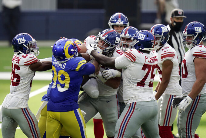 Members of the Los Angeles Rams and New York Giants get into a shoving match during the second half of an NFL football game Sunday, Oct. 4, 2020, in Inglewood, Calif. (AP Photo/Jae C. Hong)