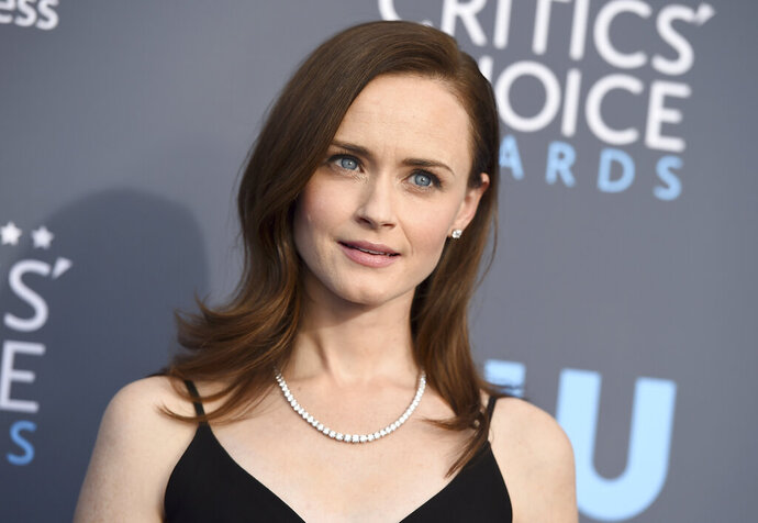 FILE - This Jan. 11, 2018 file photo shows Alexis Bledel at the 23rd annual Critics' Choice Awards in Santa Monica, Calif. Cybersecurity firm McAfee on Monday crowned Bledel the most dangerous celebrity on the internet in 2019. No other celebrity was more likely to land users on websites that carry viruses or malware.  (Photo by Jordan Strauss/Invision/AP, File)