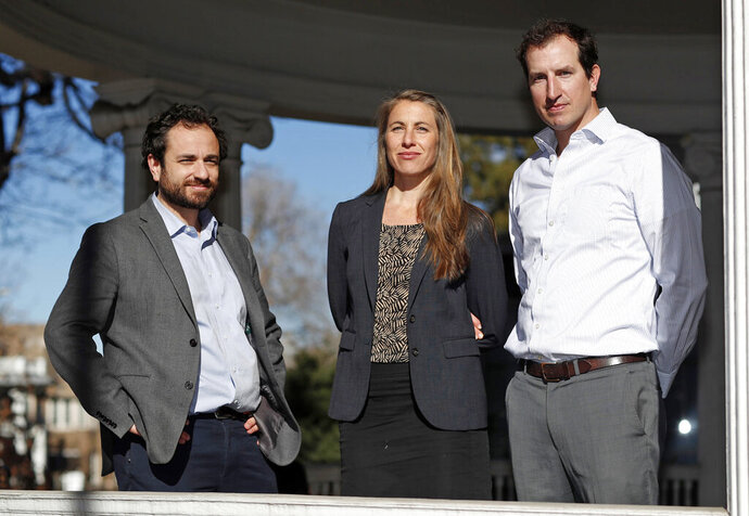 FILE - In this Dec. 20, 2018 file photo attorneys, from left, David Seligman, Nina DiSalvo and Alexander Hood, of Towards Justice, pose outside the organization's office east of downtown Denver. Low paid childcare workers from around the world could soon learn whether they will be getting payments from a proposed $65.5 million class action settlement. A federal judge in Denver is scheduled to hold a hearing Thursday, July 18, 2019, on whether to grant final approval to the deal, which was announced in January. (AP Photo/David Zalubowski, File)