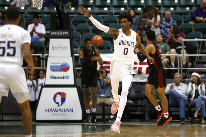 Washington forward Jayden McDaniels (0) reacts after scoring against Houston during the first half of an NCAA college basketball game Wednesday, Dec. 25, 2019, in Honolulu. (AP Photo/Marco Garcia)