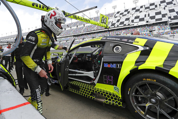 FILE - In this Jan. 3, 2020, file photo, Kyle Busch climbs in his car during testing for the upcoming Rolex 24 hour auto race at Daytona International Speedway in Daytona Beach, Fla. The Rolex 24 begins Saturday, Jan. 25.(AP Photo/John Raoux, File)